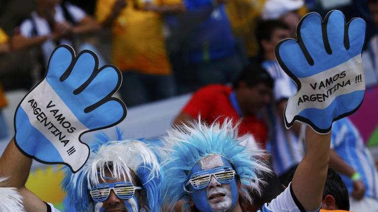 Fans of Argentina cheer before their 2014 World Cup Group F soccer match against Iran at the Mineirao stadium in Belo Horizonte