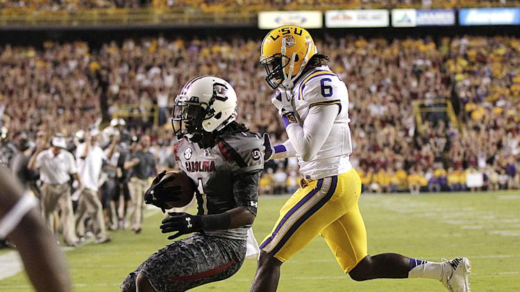 South Carolina wide receiver Ace Sanders (1) scores a touchdown in front of LSU safety Craig Loston (6) during the first half of an NCAA college football game in Baton Rouge, La., Saturday, Oct. 13, 2012. (AP Photo/Gerald Herbert)
