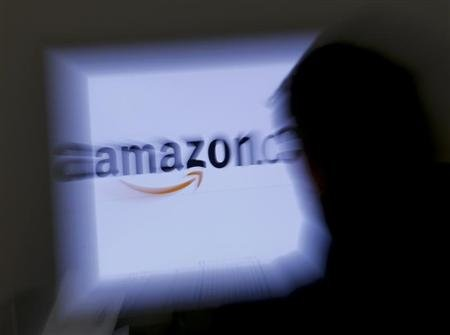 Amazon shares climb on Kindle e-book optimism
