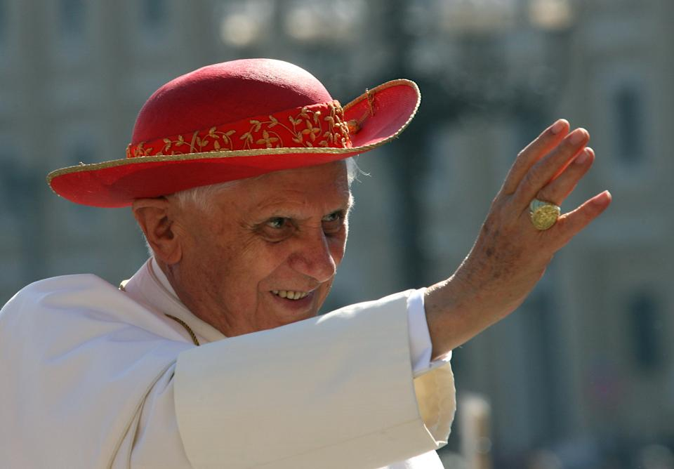 "FILE - This Sept. 6, 2006 file photo shows Pope Benedict XVI wearing a ""saturno hat"", inspired by the ringed planet Saturn, to shield himself from the sun as he waves to the crowd of faithful prior to his weekly general audience in St. Peter's Square at the Vatican. (AP Photo/Pier Paolo Cito, files)"
