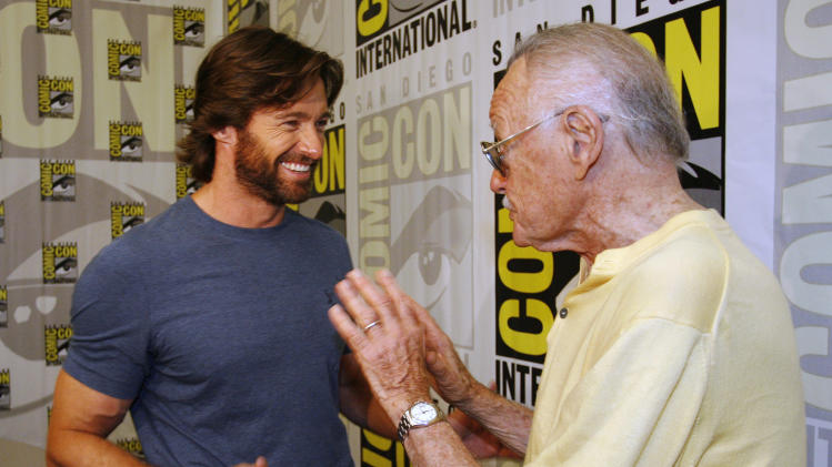 "FILE - In this July 24, 2008 file photo, actor Hugh Jackman, left, talks to legendary comic book creator Stan Lee, right, after an interview at the Comic-Con 2008 convention in San Diego. Attending Comic-Con is often a once-in-a-lifetime opportunity for many con-goers, but it's just another summertime destination for the likes of ""The Wolverine"" star Jackman, geeky funnyman Patton Oswalt and ""The Amazing Spider-Man"" sequel writers Alex Kurtzman and Roberto Orci. (AP Photo/Denis Poroy)"