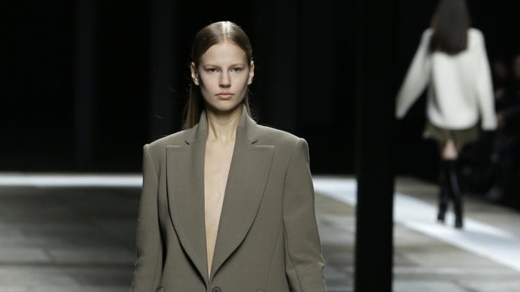 A model walks the runway during the Theyskens Theory Fall 2013 runway show at Fashion Week in New York, Monday, Feb. 11, 2013.  (AP Photo/Kathy Willens)