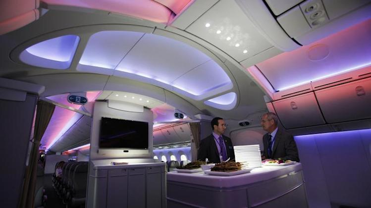 Boeing executives speak along archway of 787 Dreamliner during demonstration flight of aircraft at Singapore Airshow in Singapore
