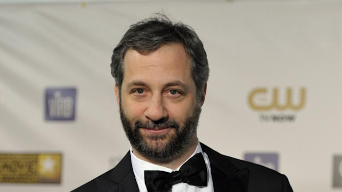 Judd Apatow poses backstage with the Critics' Choice Louis XIII Genius Award at the 18th Annual Critics' Choice Movie Awards at the Barker Hangar on Thursday, Jan. 10, 2013, in Santa Monica, Calif. (Photo by John Shearer/Invision/AP)