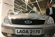A visitor checks out a Russian-made Lada 2170 sedan at the 62nd International Motor Show (IAA) in Frankfurt, 2007. Renault and its Japanese subsidiary Nissan announced a big step in the Russian market, heading for control of the Lada brand to become the third-biggest auto force in the world