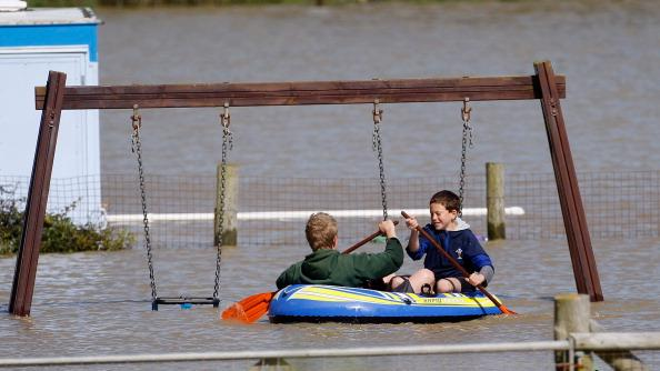 Children play in a flooded play park in the seaside village of Borth on June 9, 2012 in Aberystwyth, Wales. Severe flooding has affected mid Wales with a major rescue operation under way taking to safety nearly 100 people so far. (Photo by Christopher Furlong/Getty Images)