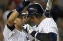 New York Yankees Derek Jeter congratulates Alex Rodriguez after his two-run home run against Tampa Bay Rays in MLB game in New York