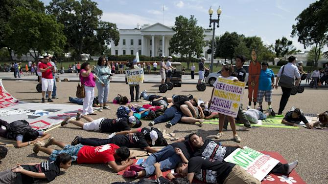 demonstrators lying in front of the White House