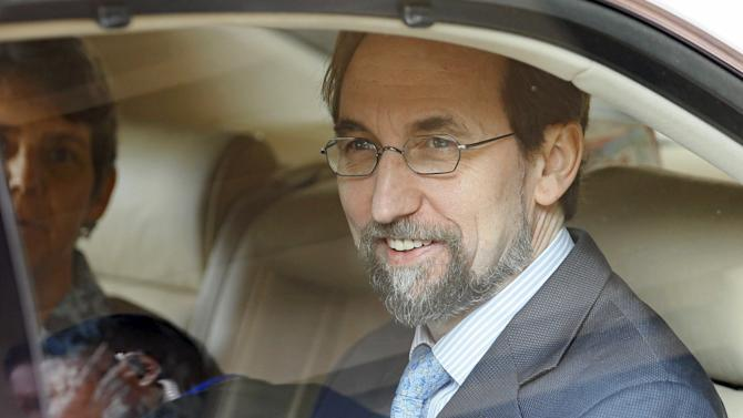 UN High Commissioner for Human Rights Zeid Ra'ad Al Hussein smiles after meeting the media while leaving his hotel to meet Sri Lankan politicians and diplomats in Colombo