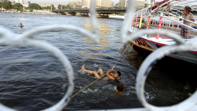Egyptian boys swim in the Nile River, in Cairo, Egypt, Thursday, June 6, 2013. Egyptian officials tried to cool tensions with Ethiopia Wednesday over the new Nile River dam project by highlighting its 'neighborliness' as the Ethiopian prime minister's spokesman insisted that nothing would stop the dam from being completed upstream from Egypt, which is wholly dependent on Nile River water.(AP Photo/Amr Nabil)