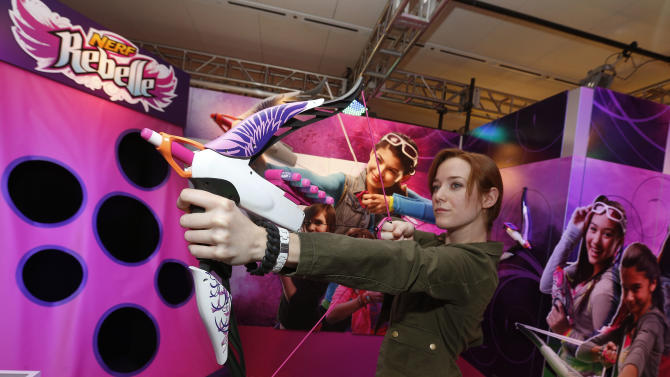 Demonstrator Kaitlin Large practices with the NERF REBELLE HEARTBREAKER Bow in Hasbro's showroom at the American International Toy Fair, Saturday, Feb. 9, 2013, in New York.  Available at retail Fall 2013, the HEARTBREAKER Bow is part of a collection of bows and blasters inspired by current pop culture trends from the new NERF REBELLE brand, a global lifestyle brand that combines active play with social interaction. (Photo by Jason DeCrow/Invision for Hasbro/AP Images)