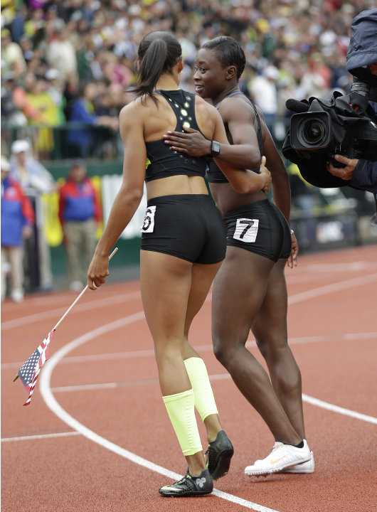 Allyson Felix, left, and Jeneba Tarmoh speak after the finish of the women's 200 meters at the U.S. Olympic Track and Field Trials Saturday, June 30, 2012, in Eugene, Ore. Felix won the 200 but she an