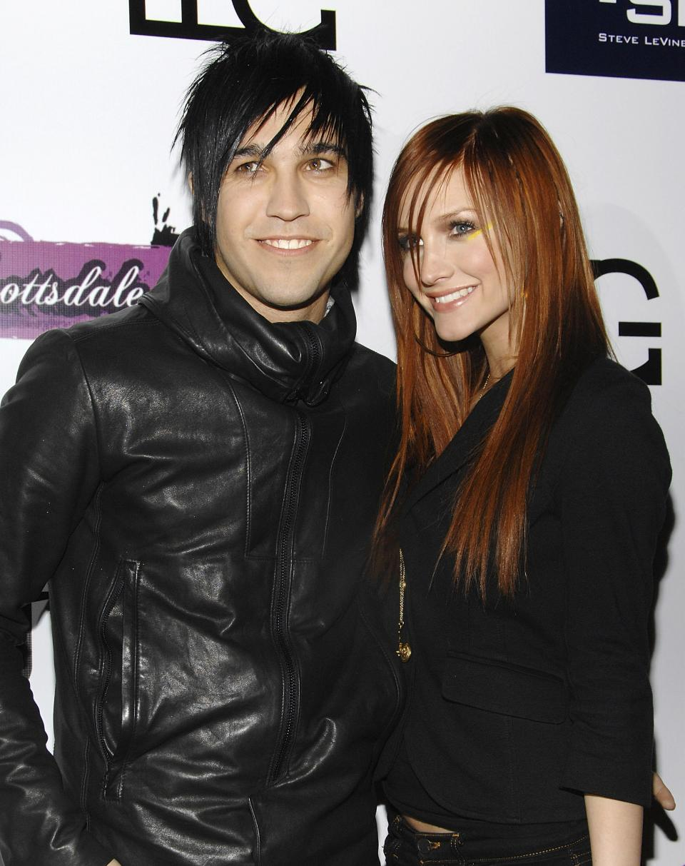 FILE - In this Jan. 30, 2008 file photo, singer Ashlee Simpson and rocker Pete Wentz arrive at Myst night club in Scottsdale, Ariz. Court records show a judge finalized their divorce on Nov. 22 in Los Angeles, but the former couple are keeping the exact terms confidential. (AP Photo/Evan Agostini, File)