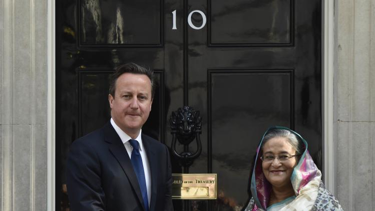 Britain's Prime Minister David Cameron greets Bangladesh's Prime Minister Sheikh Hasina outside 10 Downing Street in central London