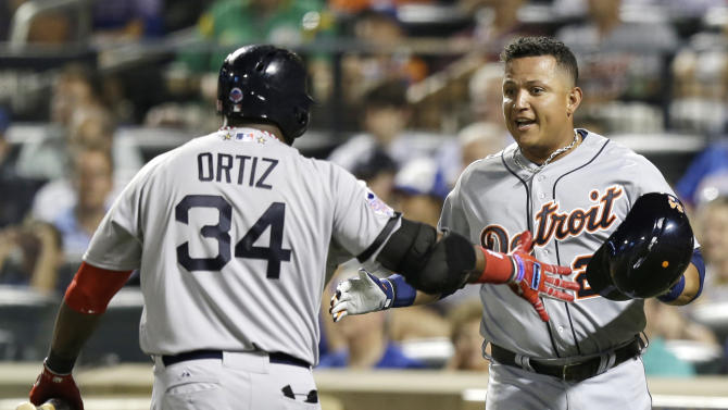American League's Miguel Cabrera, of the Detroit Tigers, is congratulated by David Ortiz, of the Boston Red Sox, after scoring on Toronto Blue Jays' Jose Bautista's sacrifice fly during the fourth inning of the MLB All-Star baseball game, on Tuesday, July 16, 2013, in New York.(AP Photo/Kathy Willens)