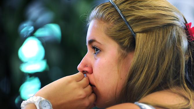 """Penn State student Jessica Knoll begins to cry as she watches the televised news conference held by former FBI director Louis Freeh after the release of his report on the Jerry Sandusky child sex abuse scandal in the HUB building on the main campus in State College, Pa., Thursday, July 12, 2012. Freeh's investigation found that senior Penn State officials, including Hall of Fame football coach Joe Paterno, """"concealed critical facts"""" about Jerry Sandusky's child abuse because they were worried about bad publicity. (AP Photo/Centre Daily Times, Nabil K. Mark)"""