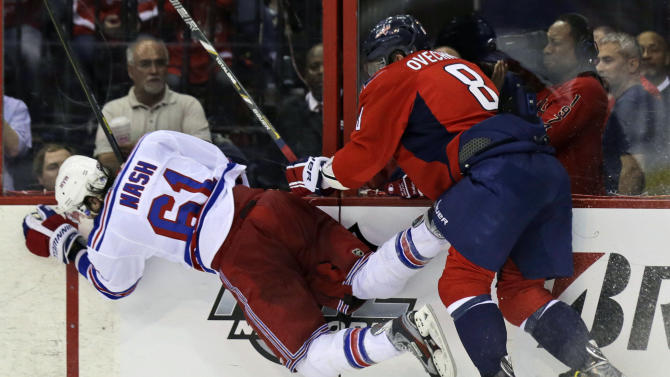 Washington Capitals left wing Alex Ovechkin (8), from Russia, checks New York Rangers left wing Rick Nash (61) into the boards in the third period of Game 1 of a Stanley Cup NHL playoff hockey series on Thursday, May 2, 2013, in Washington. The Capitals won 3-1. (AP Photo/Alex Brandon)