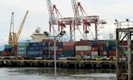A crane stacks shipping containers of Philippine products for export at the international container port in Manila in September 2012. Philippine exports recorded their biggest slump for the year in August as demand for electronic products plunged in the United States, China and other key markets, the government said Wednesday