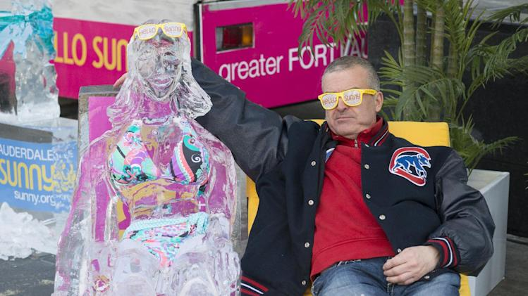 IMAGE DISTRIBUTED FOR GREATER FORT LAUDERDALE - Passerby Robert Heyde gets the cold shoulder as the Greater Fort Lauderdale Convention & Visitors Bureau says goodbye chilly, Hello Sunny today on Michigan Avenue in Chicago with their Hello Sunny campaign, Wednesday Feb. 6, 2013. The CVB's promotion encourages Chicagoans and the nation to enjoy the warm Greater Fort Lauderdale sunshine. Visit www.sunny.org/defrost for a chance to win a Fort Lauderdale beach getaway. (Peter Barreras/Invision for Greater Fort Lauderdale/AP Images)