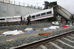 Emergency personnel respond to the scene of a train …