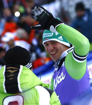 Felix Neureuther of Germany celebrates in the finish area after winning an alpine ski, men's World Cup giant slalom in Adelboden, Switzerland, Saturday, Jan. 11, 2014. Felix Neureuther overcame a big first-run deficit to win a World Cup giant slalom on Saturday for his second straight victory in 2014. (AP Photo/Giovanni Auletta)