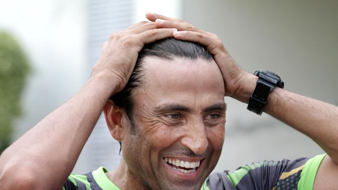 Pakistani cricket player Younis Khan speaks to reporters in Lahore, Pakistan, Tuesday, May 27, 2014. Ex-captain Younis Khan says after playing international cricket for more than a decade he deserves a place in Pakistan's limited-overs squad and wants to play in next year's World Cup. (AP Photo/K.M. Chaudary)
