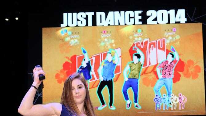 """McKayla Maroney plays """"Just Dance 2014"""" at the Ubisoft booth at E3 on Wednesday, June 12, 2013, in Los Angeles. (Photo by Alexandra Wyman/Invision for Ubisoft/AP Images)"""
