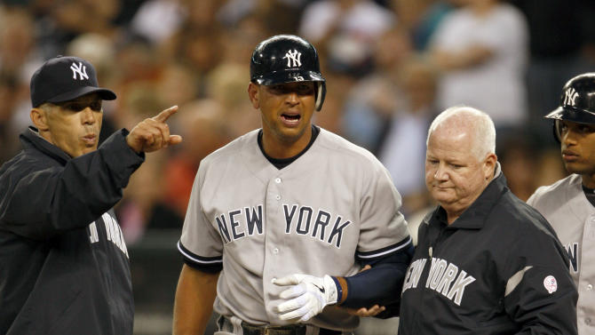 New York Yankees'manager Joe Girardi, left, points as, Alex Rodriguez, middle, leaves the game after being hit by a pitch in the eighth inning of a baseball game against the Seattle Mariners, Tuesday, July 24, 2012, in Seattle. (AP Photo/Kevin P. Casey)