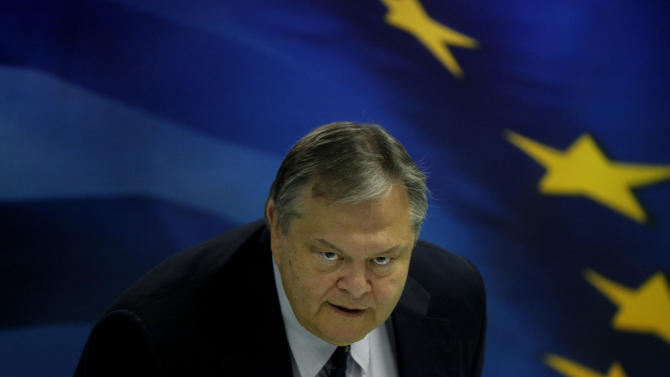 """Greek finance minister Evangelos Venizelos addresses the media during a press conference on the state of the Greek economy in Athens on Friday, Sept. 2, 2011. Venizelos rejected  reports that the country's international debt review has been suspended due to a break-down in talks, saying the pause was scheduled and insisted the government would not impose any additional revenue-generating measures beyond what had already been agreed and voted on in Parliament as part of conditions for Greece's bailout. The finance minister said the country is in a deeper recession than originally forecast _ he estimated the economic contraction will be """"very close"""" to 5 percent this year.(AP Photo/Kostas Tsironis)"""
