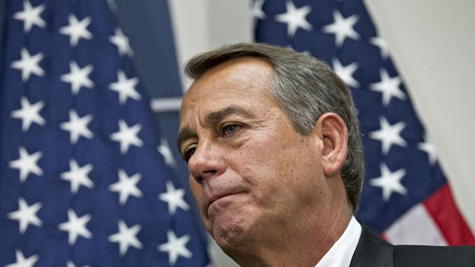 "House Speaker John Boehner of Ohio, who conferred with President Barack Obama by phone yesterday, listens during a news conference on Capitol Hill in Washington, Wednesday, Dec. 12, 2012,  following a closed-door meeting with the GOP caucu. Boehner and the other House Republican leaders are calling for Obama to come up with plan they can accept for spending cuts and tax revenue to avoid the so-called ""fiscal cliff"" of automatic tax hikes and budget reductions. (AP Photo/J. Scott Applewhite)"