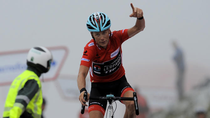 Christopher Horner of the United States gestures as he finishes second to retain the overall lead at the end of the 20th stage of the Vuelta cycling race, a 142.2 kilometer (88.4 mile) leg between Aviles and Alto L'Angliru, northern Spain, Saturday, Sept. 14, 2013. (AP Photo/Alvaro Barrientos)