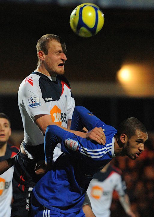 Bolton Wanderers' English Defender David Wheater (L) Clears From Macclesfield Town's English Midfielder Colin Daniel AFP/Getty Images