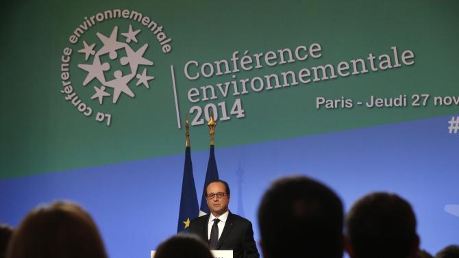French President Hollande delivers his speech during the Environmental Conference at the Elysee Palace in Paris