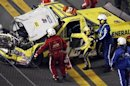 Jason Leffler is pulled from his number 18 Toyota after a crash in the NASCAR Camping World Series in Daytona Beach