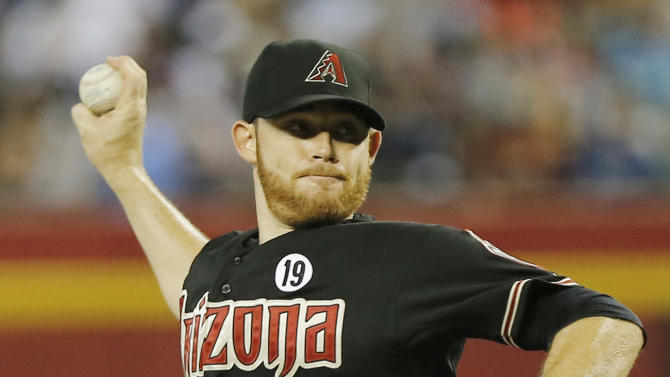 Arizona Diamondbacks pitcher Ian Kennedy delivers a pitch against the Los Angeles Dodgers during the first inning of a baseball game, Tuesday, July 9, 2013, in Phoenix. (AP Photo/Matt York)