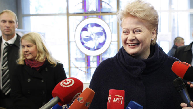 Lithuania's President Dalia Grybauskaite speaks to the media at a polling station in Vilnius, Lithuania, Sunday, Oct. 14, 2012. Lithuanians are expected to deal a double-blow to the incumbent conservative government in national elections Sunday by handing a victory to opposition leftists and populists and saying 'no' to a new nuclear power plant that supporters claim would boost the country's energy independence. (AP Photo/Mindaugas Kulbis)