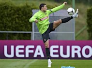 Portugal's national football team forward Cristiano Ronaldo controls the ball during a training session at the team's base camp on June 5 in Opalenica. Experienced centre-back Per Mertesacker has said Germany's defence must be on their guard against Ronaldo on Saturday in their opening Euro 2012 match