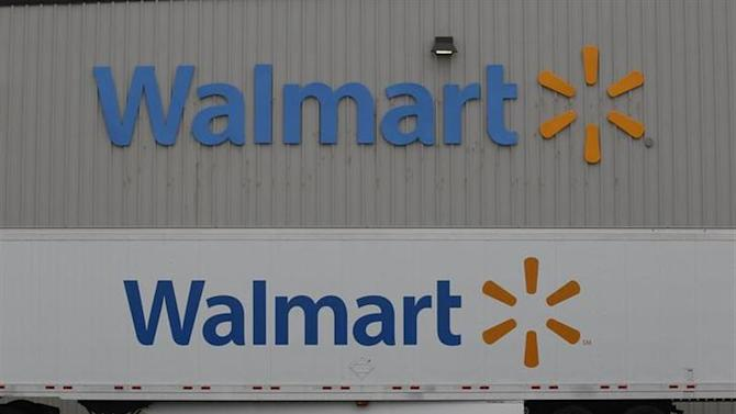 The Wal-Mart company logo is seen outside a Wal-Mart Stores Inc company distribution center in Bentonville, Arkansas June 6, 2013. REUTERS/Rick Wilking/Files