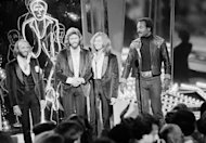 FILE - In this Dec. 8, 1977, file photo, The Bee Gees, from left, Maurice, Barry and Robin Gibb, join actor Jim Brown, right, on Stage 14 of Paramount Studios during a disco party for the premiere of &quot;Saturday Night Fever&quot; in Los Angeles. A representative said on Sunday, May 20, 2012, that Robin Gibb has died at the age of 62. (AP Photo/File)
