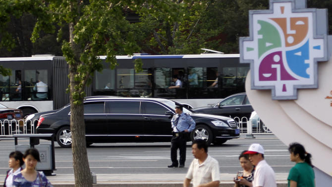 A stretch limousine believed to be carrying North Korean leader Kim Jong Il drives ahead of a convoy of cars traveling towards the Great Hall of the People in Beijing, China, Wednesday, May 25, 2011. Kim reportedly arrived in Beijing on Wednesday for a meeting with Chinese President Hu Jintao that would highlight the influence the economic powerhouse has with the isolated regime struggling to feed its people. (AP Photo/Ng Han Guan)