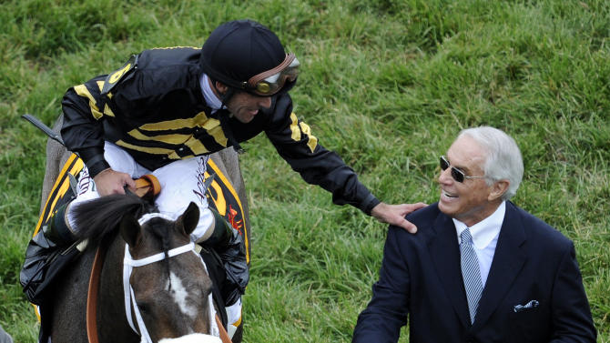 Jockey Gary Stevens, aboard Oxbow, celebrates with trainer D. Wayne Lukas after winning the Preakness Stakes horse race at Pimlico Race Course, Saturday, May 18, 2013, in Baltimore. (AP Photo/Nick Wass)