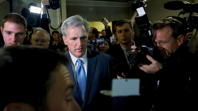 McCarthy is surrounded by reporters as he walks to microphones to explain his decision to pull out of a Republican caucus secret ballot vote to determine the nominee to replace Boehner, on Capitol Hill in Washington