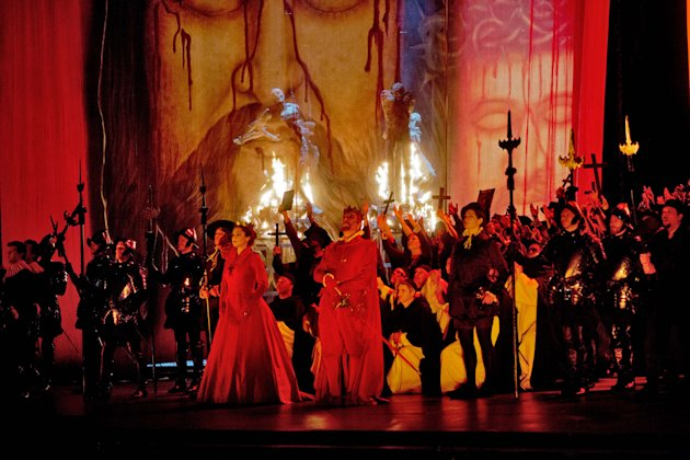 "In this Feb. 19, 2013 photo provided by the Metropolitan Opera, the cast fill the stage during a dress rehearsal of ""Don Carlo"" at the Metropolitan Opera in New York. (AP Photo/Metropolitan Opera, Ken Howard)"