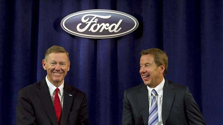 Ford Motor Company President and CEO Alan Mulally, left,  shares a laugh with Executive Chairman for Ford  William Ford while answering questions from the media after the company's annual shareholders meeting at the Hotel DuPont in Wilmington, Del., Thursday, May 10, 2012. Thursday's meeting lasted only 45 minutes, much of it spent with shareholders praisingMulally and Ford Jr. for the company's turnaround.  (AP Photo/Ron Soliman)