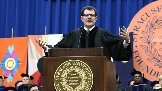 IMAGE DISTRIBUTED FOR SYRACUSE UNIVERSITY - Nicholas Kristof, Pulitzer Prize winning columnist and author, speaks during the Syracuse University 159th Commencement ceremony in Syracuse, N.Y., Sunday, May 12, 2013. (Kevin Rivoli / AP Images for Syracuse University