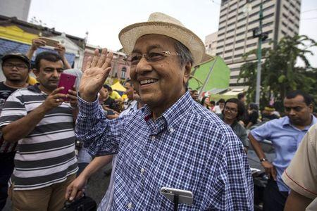 "Former Malaysian Prime Minister Mahathir Mohamad waves as he attends a rally organised by pro-democracy group ""Bersih"" (Clean) near Central Market in Malaysia's capital city of Kuala Lumpur"
