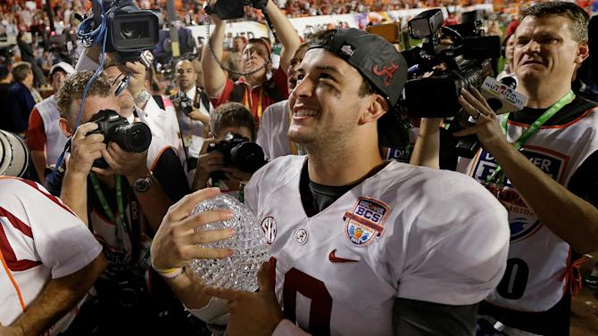 Alabama's AJ McCarron holds The Coaches' Trophy after the BCS National Championship college football game against Notre Dame Monday, Jan. 7, 2013, in Miami. Alabama won 42-14. (AP Photo/David J. Phillip)