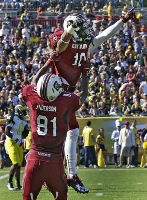 South Carolina wide receiver Damiere Byrd (10) celebrates with tight end Rory Anderson (81) after scoring on a 56-yard first-quarter touchdown against Michigan during the Outback Bowl NCAA college football game, Tuesday, Jan. 1, 2013, in Tampa, Fla. (AP Photo/Chris O'Meara)