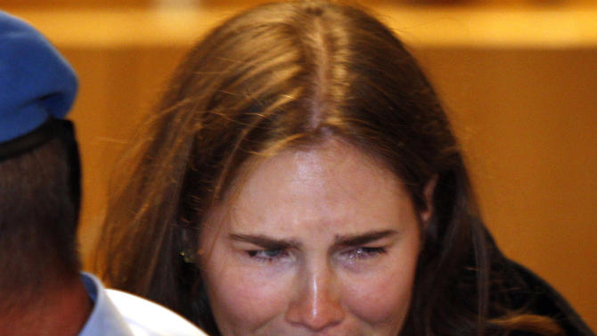 Amanda Knox breaks in tears after hearing the verdict that overturns her conviction and acquits her of murdering her British roommate Meredith Kercher, at the Perugia court, central Italy, Monday, Oct. 3, 2011. Italian appeals court threw out Amanda Knox's murder conviction Monday and ordered the young American freed after nearly four years in prison for the death of her British roommate Knox collapsed in tears after the verdict overturning her 2009 conviction was read out. Her co-defendant, Italian Raffaele Sollecito, also was cleared of killing 21-year-old Meredith Kercher in 2007. (AP Photo/Pier Paolo Cito)