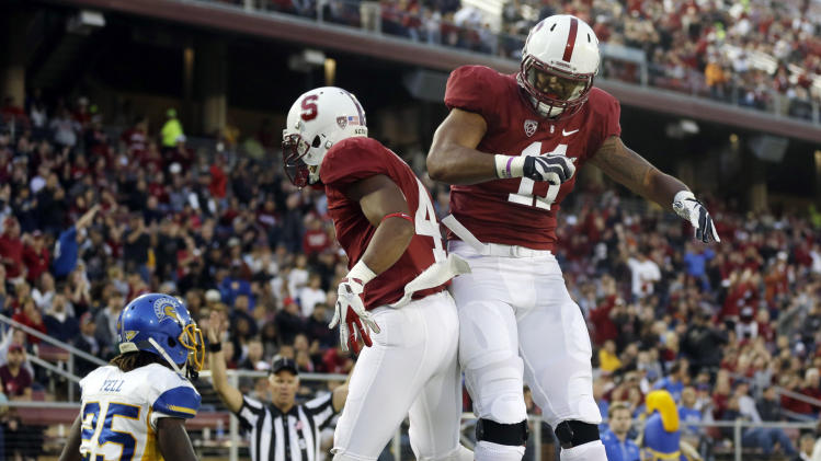 Stanford wide receiver Drew Terrell, center, celebrares his 11-yard touchdown catch with teammate Levine Toilolo (11) during the first half of an NCAA college football game in Stanford, Calif., Friday, Aug.  31, 2012. (AP Photo/Marcio Jose Sanchez)